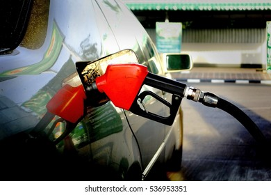 Red Fuel nozzle on a gas station.