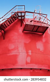 red fuel tank with a stairs on the wall