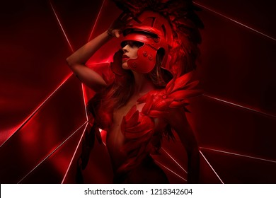 Red future, Roman warrior with helmet of feathers and horse mane. She is wearing a red dragon scales, fantasy pose
