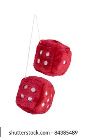 Red fuzzy dice with white dots that are usually hung from the rear view mirror of a car - path included