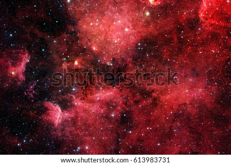 Red galaxy in outer space. Elements of this image furnished by NASA.