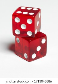 Red game dice in flight  on white background