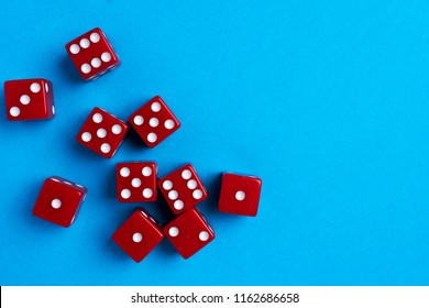 Red gaming dices on blue background. Flat lay, place for text. Game concept