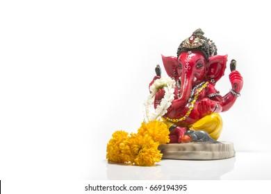 red Ganesha sculpture with flower garland or wreath