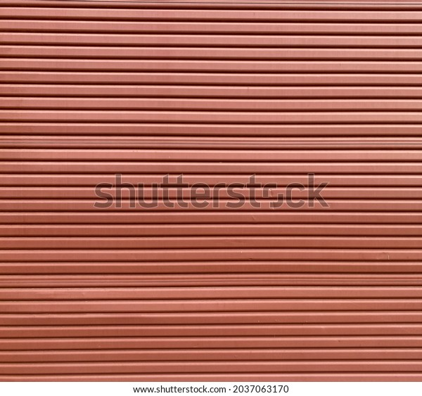 red garage shop roll up steel metal door