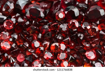 Red garnet zodiac birthstone of january,capricorn gemstone,red background