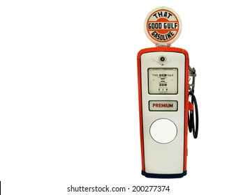 Red gas pump isolated over white background.