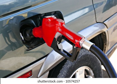 red gasoline pump nozzle