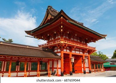 red gate of Fushimi Inari shrine, famous public temple in Japan in a sunny day