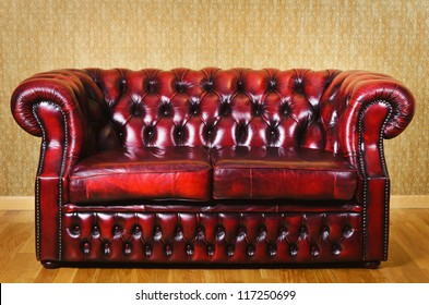 Red Genuine Leather Sofa Near The Wall