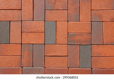Red German Ceramic Clinker Pavers. Floor pavers in a path, detail of a pavement to walk, textured background