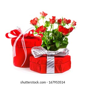 Red gift with a red bow and roses. Isolate on white background