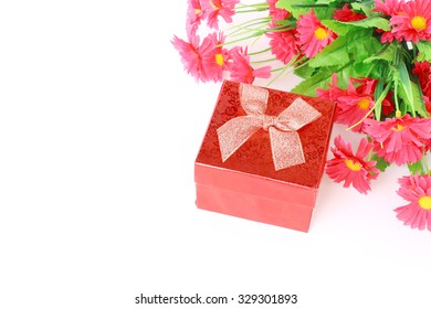 Red gift box and beautiful flower on white background and copy space