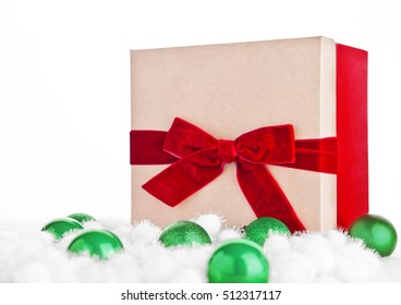 Red gift box for christmas with toys and snow on white background