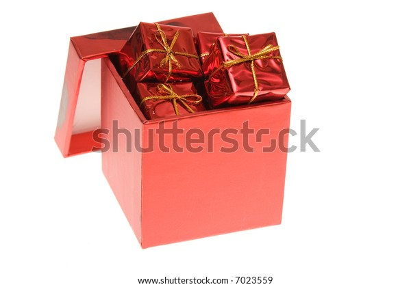 red gift box full of little Christmas gifts, isolated on white