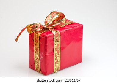 red gift box with gold decoration