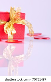 red gift box and red hearts