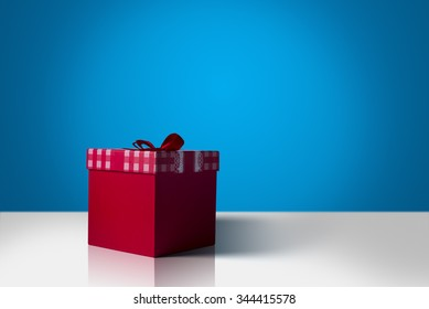 Red gift box on a blue background.