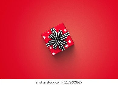 red gift box on color background