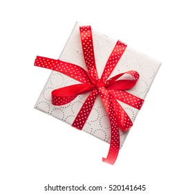 Red gift box with ribbon isolated on white