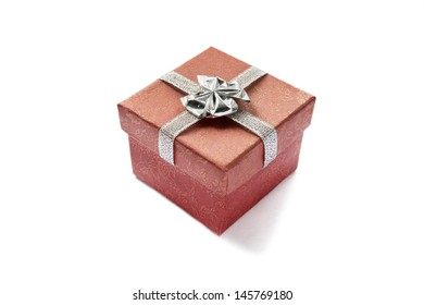 Red gift box with silver bow isolated over white