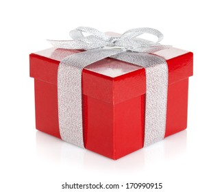Red gift box with silver ribbon and bow. Isolated on white background