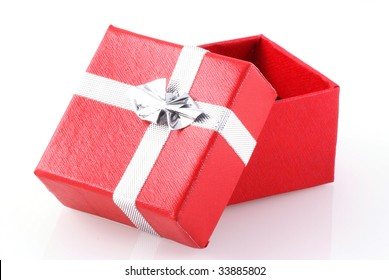 Red gift box with silver ribbon isolated on white.