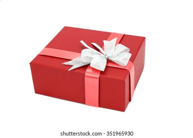 red gift box with silver ribbon on white background.