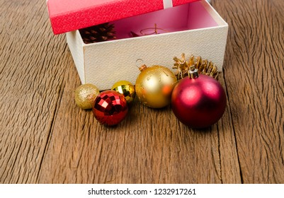 Red gift box with white bow on wooden board background