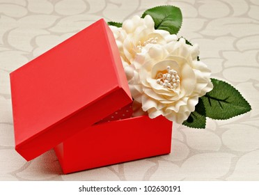 Red gift box with white flowers