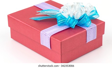 Red gift box with white ribbon isolated on white background