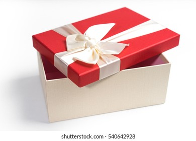 Red gift box with white ribbon isolated on white background.