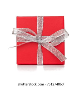 Red gift box with white ribbon isolated on white background. Close up