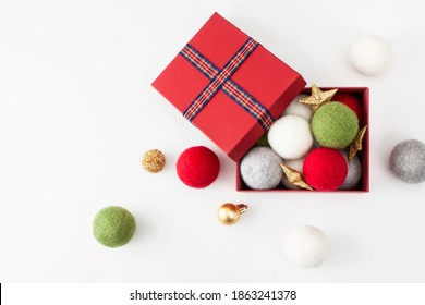 Red gift boxes and Christmas decorations on the white background with spaces.