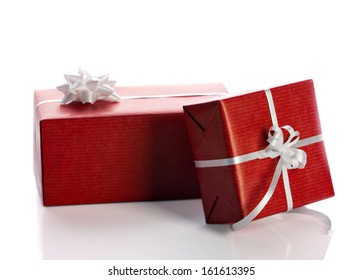 red gift boxes with white bow isolated on white