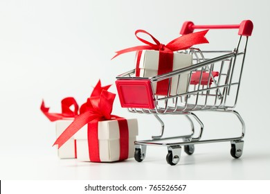 Red gift or presents box in a shopping cart, for sales promotion and rewards concept