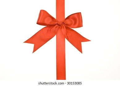 Red gift satin ribbon and bow on white background