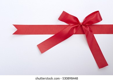 red gift satin ribbon bow on white background