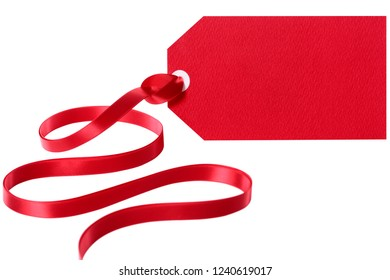 Red gift tag label with ribbon isolated white