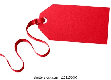 Red gift tag with ribbon isolated on white