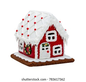 Red gingerbread house, Christmas. Handmade. Isolated on white.