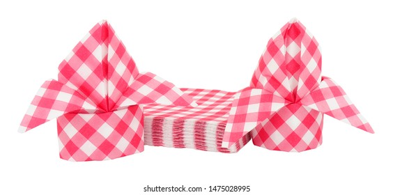 Red gingham pattern paper napkins folded into bishops mitre isolated on a white background