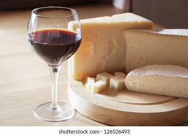 A red glass of wine and italian cheese