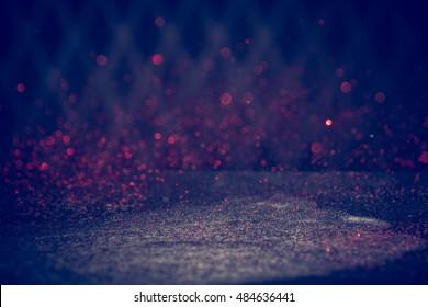Red Glitter Lights Background. Vintage Sparkle Bokeh With Selective Focus. Defocused. Vintage Filter Applied.