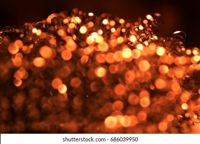 Red glitter vintage lights background. de-focused, abstract colorful de-focused circular facula,abstract background