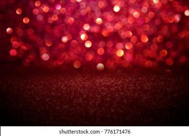 Red glitter vintage lights background.