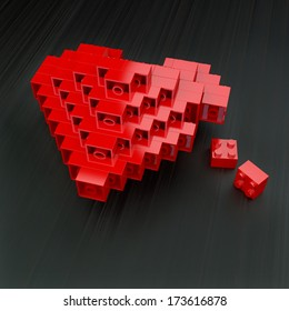 red glossy plastic heart made of building kit