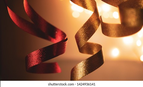 red and gold blurred ribbons for gift, shopping, sale  concept background