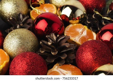 red and gold christmas balls, tangerines close-up