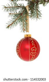 Red and gold Christmas bauble hanging from a fir tree branch